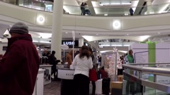 Shopper testing free coffee inside Metropolis shopping mall - stock footage