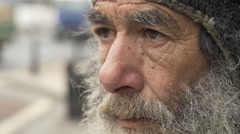 Portrait of sad old man in the street: homeless, vagabond, poor elderly man Stock Footage
