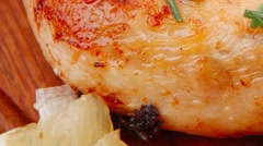Stock Video Footage of grilled chicken legs with tomatoes lemon and chives on wood