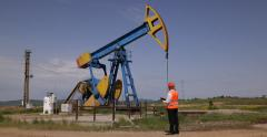 Stock Video Footage of Engineer Supervisor Worker Walking Through Oil Pump Rig Verify System Check Note