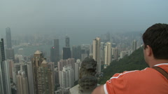 Tourists sightseeing, Hong Kong skyline Stock Footage