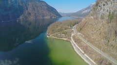 Aerial view of serpentine railroad at mountain bottom, beautiful lake, tourism Stock Footage