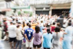 Blurred crowd of people watching a performance on the street - stock photo