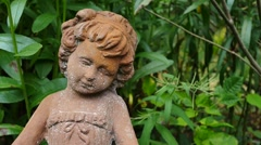 Creepy statue of young girl, close up Stock Footage