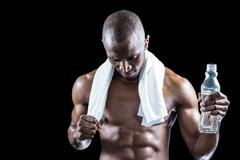Stock Photo of Athlete with towel around neck holding water bottle