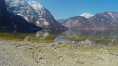 Landscape for meditation, mountains with glacier on peaks, stony bottom of lake Stock Footage