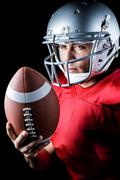 Confident American football player with ball - stock photo
