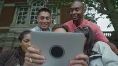 4K Happy mixed ethnicity friends outdoors in the city pose to take a selfie Stock Footage