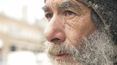 Sad old man in the street closeup portrait Stock Footage