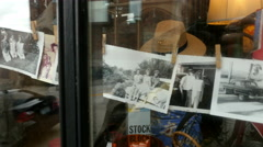 Old Photos In Shop Window Stock Footage
