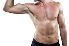 Midsection of shirtless athlete flexing muscles - stock photo