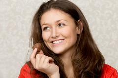 Girl with heart shaped chocolate - stock photo
