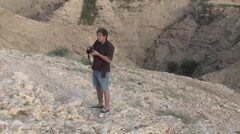 Young Man Taking Photos of The Ancient Herodium, Herod the Great's home Stock Footage