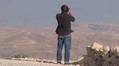 Young Man Taking Pictures On Top of The Ancient Herodium, Herod the Great's home Stock Footage