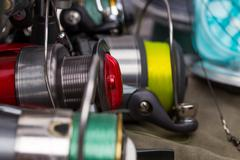 Fishing reels with line different colors Stock Photos