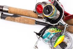 fishing tackles rods, reels, line, lures - stock photo