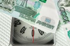 Rubble banknotes on the on the scales - stock photo