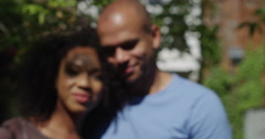 Stock Video Footage of An attractive African American get keys to their new home. Shot on RED Epic.