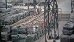 1966: Steel worker loading custom plates onto train rail cars. Stock Footage