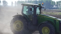 Tractor processed agricultural area in slow motion Stock Footage