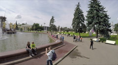 Happy people relax near fountain VDNKh. - stock footage