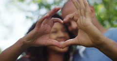 Closeup of loving couple making heart gesture together. Shot on RED Epic. Stock Footage