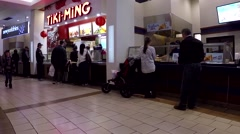 People lined up to ordering food at food court Stock Footage