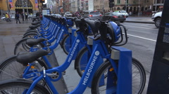 Bike share outside Flinders Station,Melbourne Stock Footage