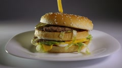 Fried potato chips falling on hamburger, slow motion, fast, junk food concept. - stock footage