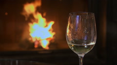 A Wine Glass in Front of the Fireplace - stock footage