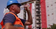Sweaty Worker Man Drink Water Bottle Torrid Summer Day Construction Builder Site Stock Footage