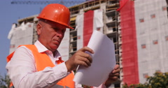 Expert Engineer Checking Blueprint Paper Plans Under Construction Area Buildings Stock Footage