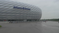 Walking in front of Allianz Arena in Munich Stock Footage