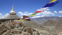 Colorful Buddhist prayer flags at temple in Shanti Stupa. Leh, Ladakh, India Stock Footage