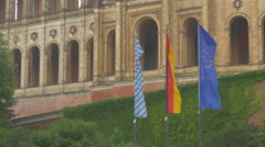 Three flags in front of Bavarian State Parliament, Munich Stock Footage