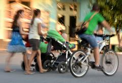 People on the street of the city. Intentional motion blur - stock photo