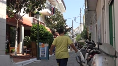 4K Amazing narrow shopping street Skiathos Island Greece tourism attraction day  Stock Footage