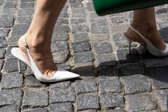 High heels on pavement Stock Photos