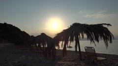 4K Beautiful sunset sunrise Greece Skiathos Island umbrella people take bath sea Stock Footage