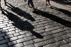 Shadow on pavement Stock Photos