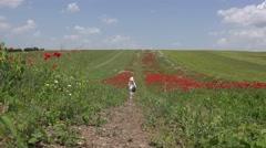 4K Happy Little Girl Walking Poppy Flowers Field Happy Children Summer Nature Arkistovideo