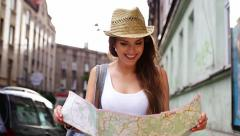 Female tourist with map visiting city Stock Footage