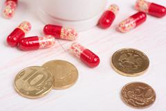 Pills and money. Health care concept - stock photo