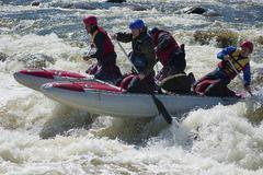 Sport catamaran on the rapid river - stock photo