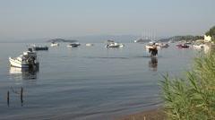 4K Crowded old port luxury yacht boat ship anchor Skiathos Island Greece iconic - stock footage