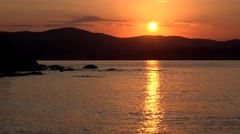 4K Timelapse sun silhouette down mountain hill sunset sunrise Greece island day  Stock Footage