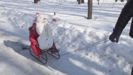 Stock Video Footage of Father Sledging Child, Snowman in Park, Little Girl Sleigh, Sledding in Winter