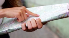 Closeup of female hand searching for direction on map - stock footage