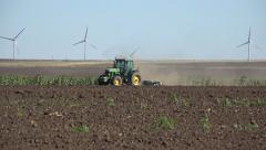 4K Tractor Plowing Field in Spring, Farmer Working in Agricultural Land, Farming Stock Footage