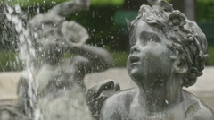 Close up with a child statue at the fountain near the Angel of Peace, Munich - stock footage